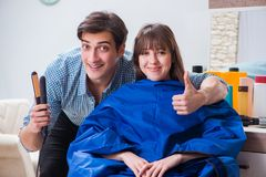 The man male hairdresser doing haircut for woman. Man male hairdresser doing haircut for woman Stock Image