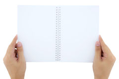 Man(male) two hands hold a empty(blank) book(note, diary) spre. A man(male) two hands hold a empty(blank) book(note, diary) spread(unfold)  white, top view Royalty Free Stock Image