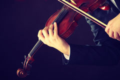 Man man dressed elegantly playing violin royalty free stock photo