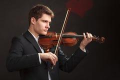 Man man dressed elegantly playing violin Royalty Free Stock Photo