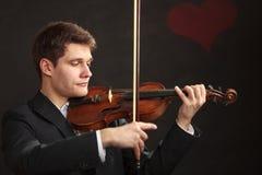Man man dressed elegantly playing violin Stock Image