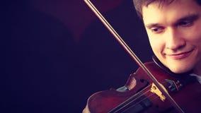 Man man dressed elegantly playing violin Royalty Free Stock Photos
