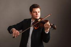 Man man dressed elegantly playing violin Stock Photography