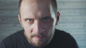 Man maniac with diabolical facial expression. close up stock video footage