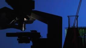 Man manipulating a microscope stock video footage