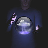 Man manipulation of sphere containing cloud lightning Stock Photo