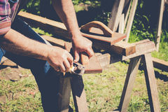 Man manufacturing wood furniture with hand tool Royalty Free Stock Photos