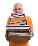 Man with many books Royalty Free Stock Images