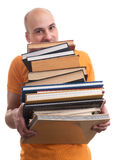 Man with many books Royalty Free Stock Photos