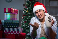 The man with many christmas gifts in boxes Stock Photography