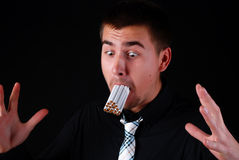 Man with many cigarettes Royalty Free Stock Photo