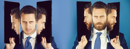 Man with many faces and profiles in mirrors. Man or serious businessman reflecting in mirror on blue background. Bearded or clean shaven face. Facial hair trend royalty free stock photo