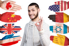 Man and many hands with different flags Royalty Free Stock Image