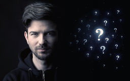 Man with many question mark near him Royalty Free Stock Photography