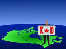 Man on map of Canada Royalty Free Stock Image
