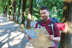 Man with a map exploring city Stock Images