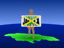 Man on map of Jamaica Royalty Free Stock Image