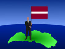 Man on map of Latvia with flag Stock Image