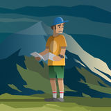 Man with map lost in the mountains. Stock Photo