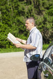 Man with the map on the rural intersection Royalty Free Stock Photography