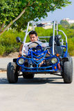 Man with map sits buggy stock photo