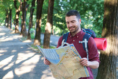 Man with a map Royalty Free Stock Photos