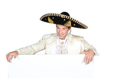 Man in a mariachi costume. With a board left blank for your message stock photo