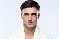 Man marked with lines for plastic surgery. Isolated royalty free stock photography