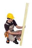 Man marking plank Royalty Free Stock Photography