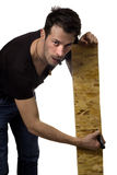 Man marking plank of wood Stock Photography