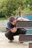 A man marks a metal product before cutting Royalty Free Stock Photography