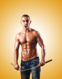 Man in martial arts concept with nunchucks Royalty Free Stock Photography