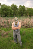 Man with a mask. Man wearing a gas mask on cloudy day Royalty Free Stock Photography