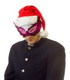 Man in mask 2. A man in mask and xmas hat on his head; over white background royalty free stock photos