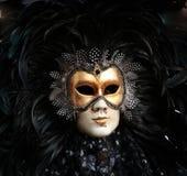 A Man in Mask. A Man wearing Venetian Mask in Black Stock Image