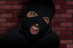Man in a mask and a black shirt. Balaclava. Royalty Free Stock Images