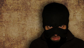 Man in a mask and a black shirt. Balaclava. Royalty Free Stock Photography