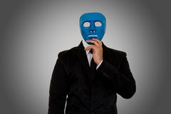 Man and mask. Businessman wearing blue mask on gray background with clipping path. Someone who wears a mask when socializing Royalty Free Stock Image