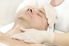 Man in the mask cosmetic procedure Royalty Free Stock Photos