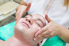 Man in the mask cosmetic procedure Royalty Free Stock Photography