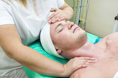 Man in the mask cosmetic procedure Stock Images