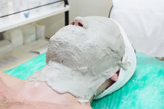 Man in the mask cosmetic procedure Stock Photography
