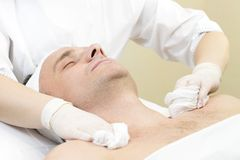Man in the mask cosmetic procedure Stock Photo