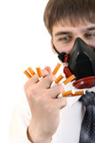 Man in Mask Crushing a Cigarettes Royalty Free Stock Photography