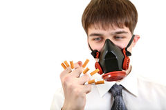 Man in Mask Crushing a Cigarettes Stock Photo