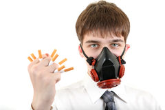 Man in Mask Crushing a Cigarettes Royalty Free Stock Photos