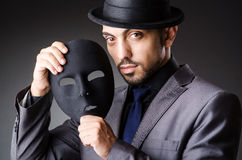 Man with mask. In the dark Stock Photography