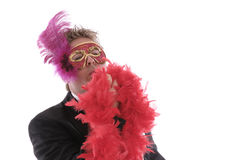 Man with mask and feather boa Royalty Free Stock Images