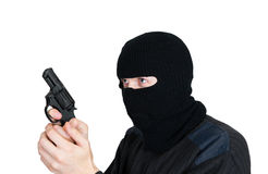Man in a mask with a gun Royalty Free Stock Photography