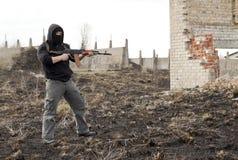 Man in mask with gun Royalty Free Stock Image